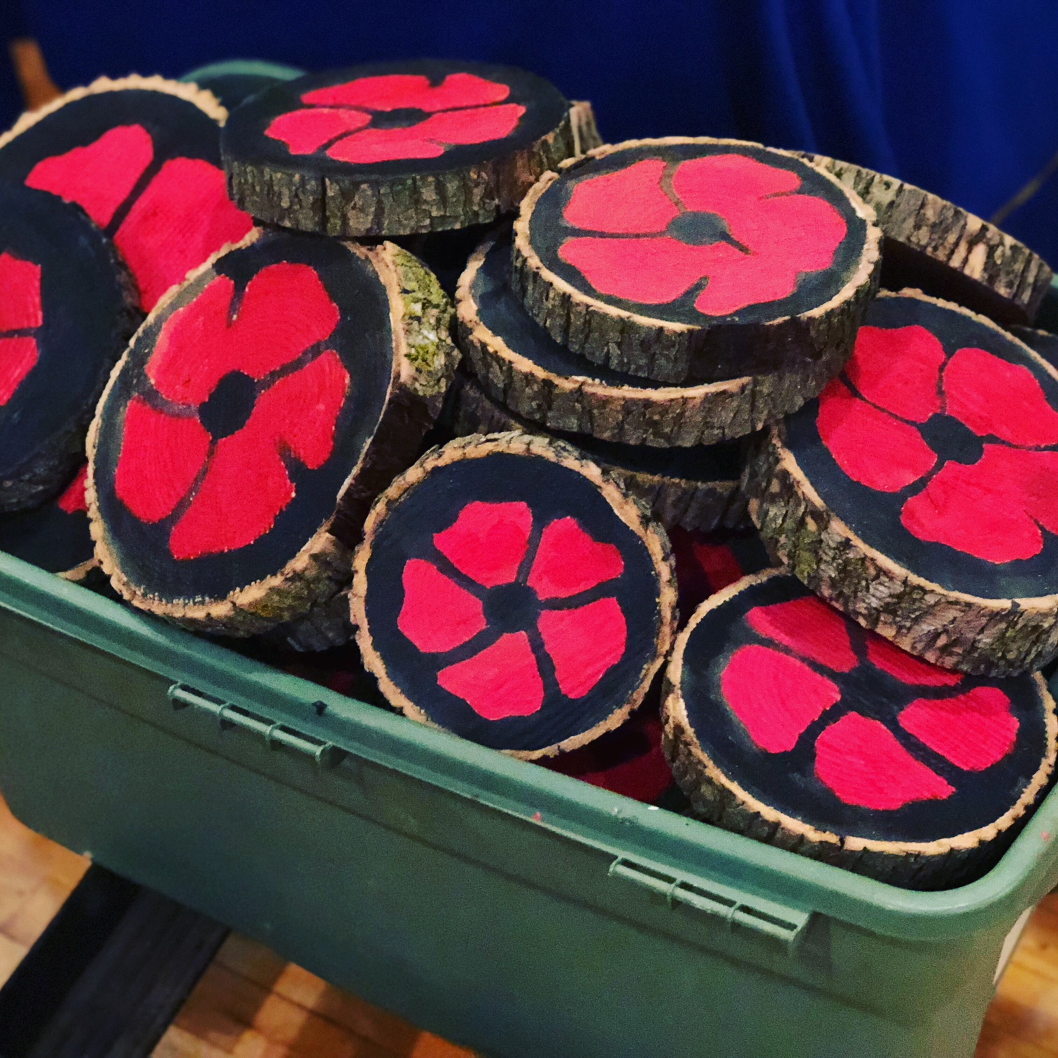 bucket filled with wooden poppies