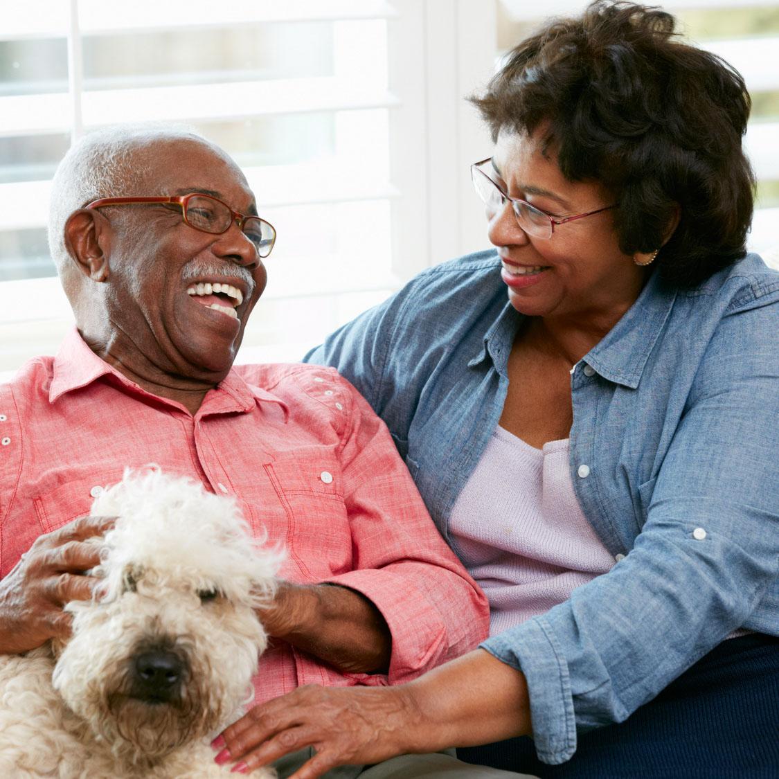 senior couple with dog