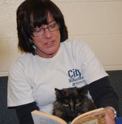 woman reading to cat